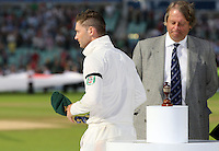 Losing Australia captain Michael Clarke walks past the urn - England vs Australia - 5th day of the 5th Investec Ashes Test match at The Kia Oval, London - 25/08/13 - MANDATORY CREDIT: Rob Newell/TGSPHOTO - Self billing applies where appropriate - 0845 094 6026 - contact@tgsphoto.co.uk - NO UNPAID USE