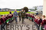 Sergeant Chris Hoare and Gunner James Power with Principal Ed O'Brian are greeted with a Guard of honour by flag waving pupils of Holy Family School when they came to deliver the tricolour and Proclamation to Holy Family School Tralee to commemorate the 100 year anniversary on Monday