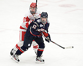 Kayla Tutino (BU - 8), Emily Snodgrass (UConn - 62) - The Boston University Terriers defeated the visiting University of Connecticut Huskies 4-2 on Saturday, November 19, 2011, at Walter Brown Arena in Boston, Massachusetts.