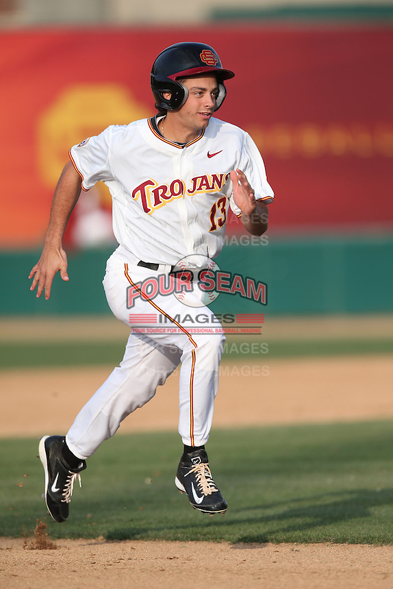Angelo La Bruna (13) of the Southern California Trojans runs the bases during a game against the Oakland Grizzlies at Dedeaux Field on February 21, 2015 in Los Angeles, California. Southern California defeated Oakland, 11-1. (Larry Goren/Four Seam Images)