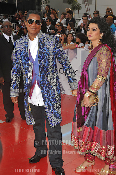 "Jermaine Jackson & wife Halima Rashid at the premiere of Michael Jackson's ""This Is It"" at the Nokia Theatre, L.A. Live in downtown Los Angeles..October 27, 2009  Los Angeles, CA.Picture: Paul Smith / Featureflash"