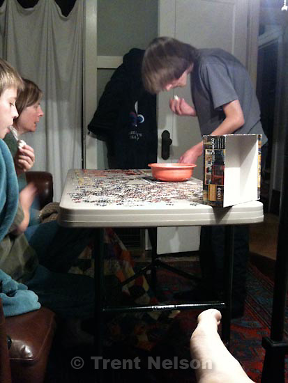 . Sunday, November 1 2009.Nathaniel Nelson Laura Nelson Noah Nelson working on puzzle. trent feet