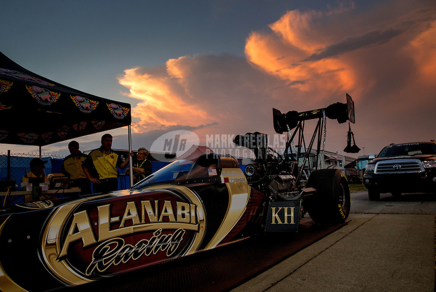 Aug. 30, 2013; Clermont, IN, USA: The car of NHRA top fuel dragster driver Khalid Albalooshi goes through tech inspection as the sun sets during qualifying for the US Nationals at Lucas Oil Raceway. Mandatory Credit: Mark J. Rebilas-