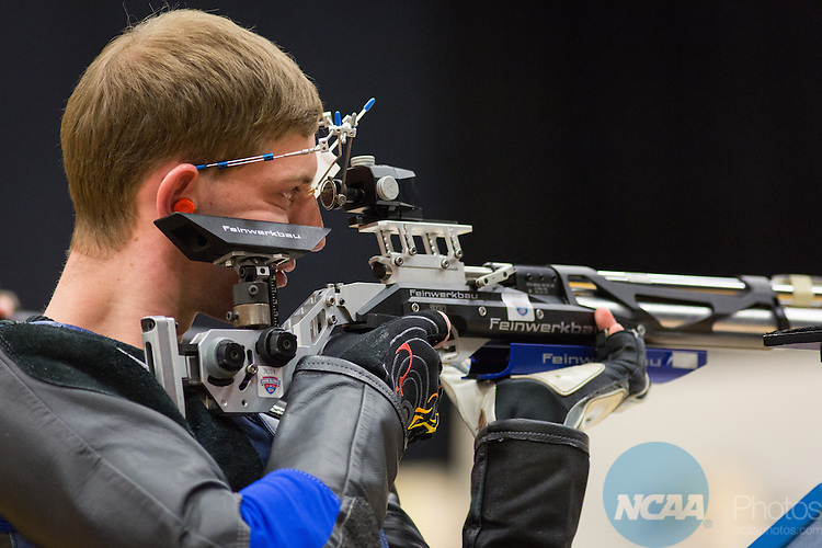 14 MAR 2015: Air Force Academy's Ryan Jacobs takes a shot in the air rifle finals during the Division I Rifle Championship held at the UAF Patty Center on the University of Alaska Fairbanks campus in Fairbanks, AK. JR Ancheta/NCAA