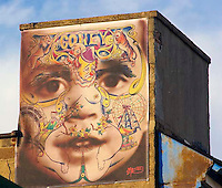 Baby and clown mural on a building at Coney Island, New York.