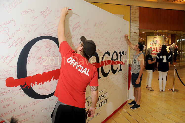 Guests sign the wall at the M.D. Anderson Back to School Fashion show at the Galleria Saturday Aug. 06,2016.(Dave Rossman Photo)