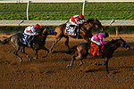 DEL MAR, CA  SEPTEMBER 3: #2 Rowayton, ridden by Drayden Van Dyke, #7 Game Winner, ridden by Mario Gutierrez, and #3 Roadster, ridden by Mike Smith, jockey for position in the stretch  of  the Del Mar Futurity (Grade l) on September 3, 2018 at Del Mar Thorougbred Club at Del Mar, CA.(Photo by Casey Phillips/Eclipse Sportswire/Getty Images)