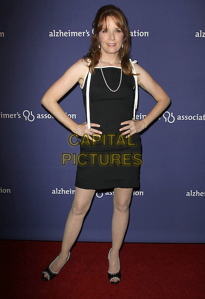 """LEA THOMPSON.18Th Annual """"A Night at Sardi's"""" Benefitting The Alzheimer's Association held At The Beverly Hilton Hotel, Beverly Hills, California, USA..March 18th, 2010.full length black white dress pearl necklace hands on hips.CAP/ADM/KB.©Kevan Brooks/AdMedia/Capital Pictures."""