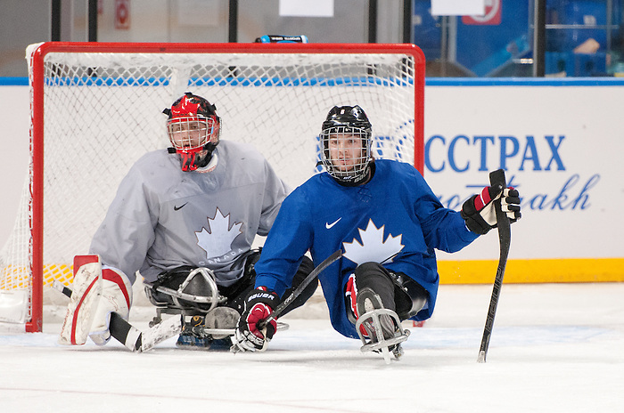 Sochi, RUSSIA - Mar 2 2014 -  Benoit St-Amand and Tyler McGregor during practice before the 2014 Paralympics in Sochi, Russia.  (Photo: Matthew Murnaghan/Canadian Paralympic Committee)