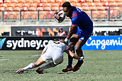 3rd February 2019, Spotless Stadium, Sydney, Australia; HSBC Sydney Rugby Sevens; England versus USA Mens semi final; Tom Mitchell of England goes low in the tackle on Matai Leuta of the United States of America