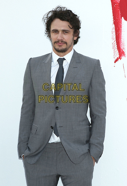 James Franco.MOCA Presents Rebel by James Franco held at the The Museum of Contemporary Art, Los Angeles, California, USA..May 12th, 2012.half length grey gray suit hands in pockets beard facial hair .CAP/ADM/RE.©Russ Elliot/AdMedia/Capital Pictures.