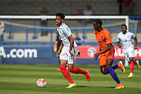 Chris Willock (Arsenal) of England U19 loses his boot under pressure from Rodney Kongolo (Manchester City) of Holland in the first attack of the match during the International match between England U19 and Netherlands U19 at New Bucks Head, Telford, England on 1 September 2016. Photo by Andy Rowland.