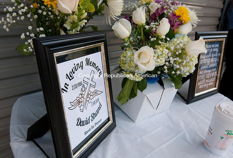 WATERBURY, CT-073014JS05- A makeshift memorial  for David Shand, sits outside the Bucks Hill Market on Wednesday afternoon. Shand, who was shot during a robbery July 20, 2014, died at Hartford Hospital on Wednesday. <br />  Jim Shannon Republican-American