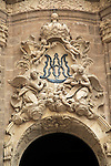 Ornately carved decorated stonework above the entrance to the cathedral church in city of Valencia, Spain