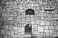 POLAND, 05.2002, Krakow - Kazimierz.The Remuh Cemetery is one of the oldest cemetery in Europe. Detail of the wall of the Graves, built in the 60's with the rest of the graves damaged by the Nazis. .By the outbreak of WWII there were 65,000 Jews in Krakow (30% of the city's population) and most lived in Kazimierz. © Bruno Cogez / Est&Ost Photography
