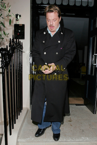 "EDDIE IZZARD .Attending Kathy Lette's ""To Love, Honour and Betray"" book launch party, London, England. .September 24th 2008. .full length black coat jacket mobile phone .CAP/AH.©Adam Houghton/Capital Pictures."