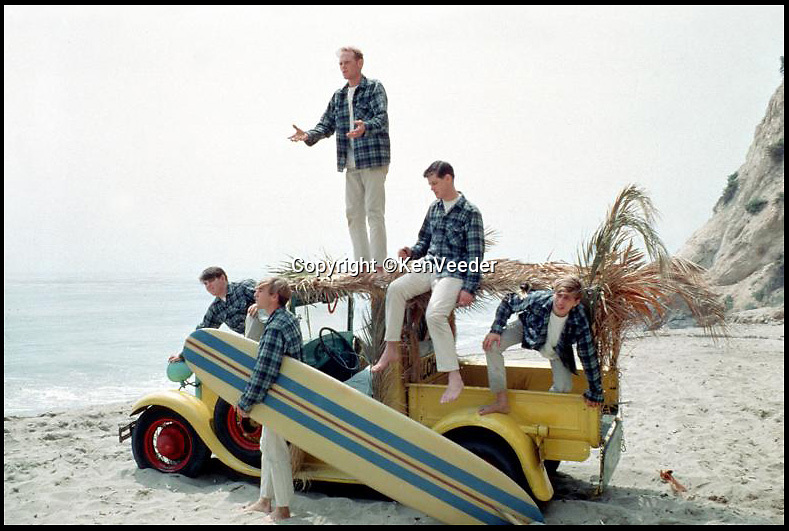 BNPS.co.uk (01202 558833)<br /> Pic: KenVeeder/RockawayRecords<br /> <br /> ****Please use full byline****<br /> <br /> A surfboard belonging to legendary Beach Boys drummer Dennis Wilson which featured on the covers of two of their most famous albums has emerged for sale for &pound;100,000.<br /> <br /> The iconic blue and yellow board was used for the cover of the Beach Boys' groundbreaking debut album, 1962's Surfin' Safari, and again in 1963 on the front of Surfer Girl.<br /> <br /> Wilson, the band's only surfer, brought the 9ft board along to the band's first ever professional photo shoot held on a beach in California in 1962 shortly after they signed with Capitol Records.<br /> <br /> The five members - Brian, Dennis and Carl Wilson, their cousin Mike Love and friend Al Jardine - were snapped holding it while striking various poses on a beach. The photos from the session went on to become some of the most iconic images of the band.<br /> <br /> Wilson gave the board to his close friend Louis Marotta in the 1970s who in turn passed it on to Beach Boys fan Bob Stafford in 1985.<br /> <br /> Mr Stafford is now selling the board with a whopping price tag of &pound;100,000 after a short stint on display at the Grammy Museum in Los Angeles to mark the band's 50th anniversary.