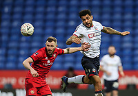 Bolton Wanderers' Josh Magennis competing with Walsall's Nicky Devlin<br /> <br /> Photographer Andrew Kearns/CameraSport<br /> <br /> Emirates FA Cup Third Round - Bolton Wanderers v Walsall - Saturday 5th January 2019 - University of Bolton Stadium - Bolton<br />  <br /> World Copyright &copy; 2019 CameraSport. All rights reserved. 43 Linden Ave. Countesthorpe. Leicester. England. LE8 5PG - Tel: +44 (0) 116 277 4147 - admin@camerasport.com - www.camerasport.com