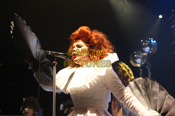 PALOMA FAITH.Performs Live in concert, Koko Camden, London, England, UK, .23rd November 2009..music gig on stage half length white ruffle collar dress neck costume prop fan  silver  microphone singing side profile .CAP/MAR.© Martin Harris/Capital Pictures.