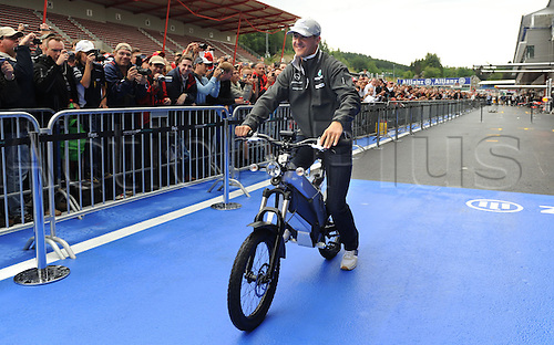 German driver Michael Schumacher of Mercedes Grand Prix rides through tge pit lane on an electric bicycle in Spa-Francorchamps, Belgium, 26 August 2010. On 29 August 2010, the Belgian Grand Prix, the 13th race of the Formula One season,