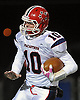 MacArthur quarterback No. 10 Jimmy Kelleher scrambles for first down during a Nassau County varsity football Conference II semifinal against Carey at Hofstra University on Friday, Nov. 13, 2015. The teams went to halftime tied 15-15.<br /> <br /> James Escher