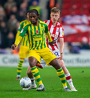 4th November 2019; Bet365 Stadium, Stoke, Staffordshire, England; English Championship Football, Stoke City versus West Bromwich Albion; Romaine Sawyers of West Bromwich Albion under pressure from Sam Clucas of Stoke City - Strictly Editorial Use Only. No use with unauthorized audio, video, data, fixture lists, club/league logos or 'live' services. Online in-match use limited to 120 images, no video emulation. No use in betting, games or single club/league/player publications
