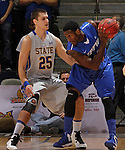SIOUX FALLS, SD - MARCH 11:  xxxxxxxxxxx of IPFW shields the ball from Chad White #25 of South Dakota State during their semi-final game at the 2013 Summit League Basketball Championships Monday at the Sioux Falls Arena.  (Photo by Dick Carlson/Inertia)