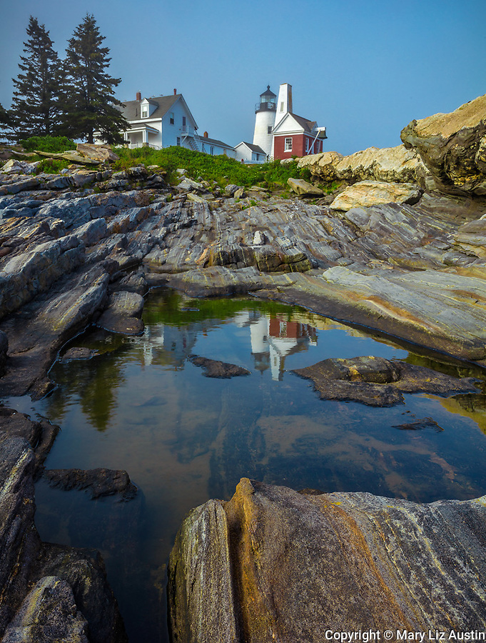 Lincoln County, ME: Pemaquid Point Lighthouse (1835) reflected in a small pool in the granite rock forms of Pemaquid Point