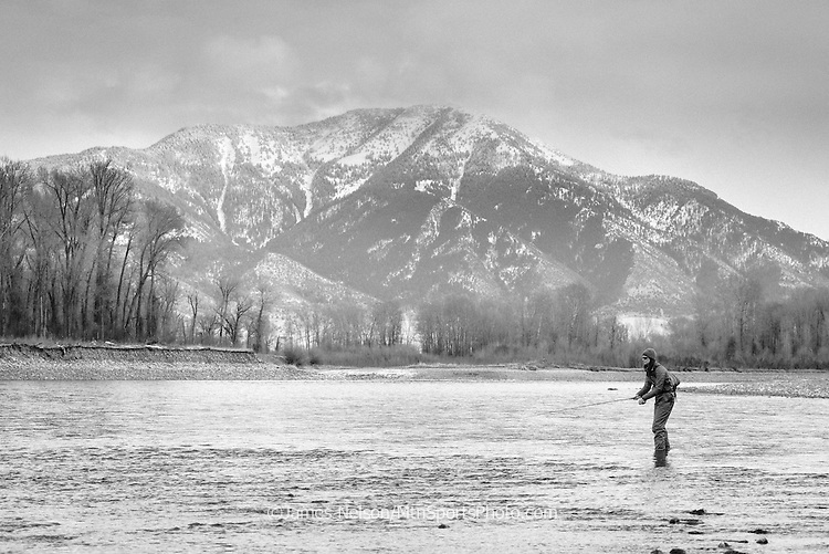 Alexis Metcalf fly fishes for trout during a winter day on the South Fork of the Snake River, Idaho.