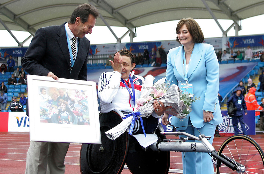 Photo: Paul Thomas..VISA Paralympic World Cup 2007. Athletics. 13/05/2007...Tanni Grey Thompson of Great Britain recieves a presentation from Cherie Blair (L) and Lynn Davies.