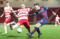 Shay McCartan of Bradford City has his shot blocked by Luke McCullough of Doncaster Rovers during the Sky Bet League 1 match between Doncaster Rovers and Bradford City at the Keepmoat Stadium, Doncaster, England on 19 March 2018. Photo by Thomas Gadd.