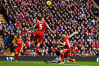Sunday, 23 February 2014<br /> Pictured: Swansea City's Wilfried Bony wins a penalty following the challenge by Liverpool's Martin Skrtel<br /> Re: Barclay's Premier League, Liverpool FC v Swansea City FC v at Anfield Stadium, Liverpool Merseyside, UK.