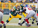 Green Bay Packers offensive linemen Josh Sitton (71) and Scott Wells (63) block New York Giants defensive lineman Rocky Bernard (95) during an NFL divisional playoff football game on January 15, 2012 in Green Bay, Wisconsin. The Giants won 37-20. (AP Photo/David Stluka)