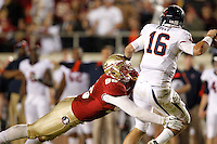 TALLAHASSEE, FL 11/19/11-FSU-UVA111911 CH-Florida State's Bjoern Werner attempts to sack Virginia quarterback Michael Rocco during second half action Saturday at Doak Campbell Stadium in Tallahassee. The Seminoles lost to the Cavaliers 14-13..COLIN HACKLEY PHOTO