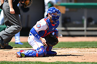 Tennessee Smokies catcher Ian Rice (5) attempts to field the throw during a game against the Jackson Generals at Smokies Stadium on April 11, 2018 in Kodak, Tennessee. The Generals defeated the Smokies 6-4. (Tony Farlow/Four Seam Images)