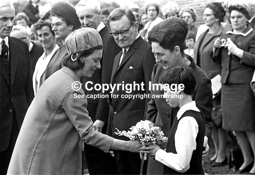 Princess Margaret receives a posie of flowers from 8 year old Margaret Clarke, a pupil at Jordanstown School, Newtownabbey, during her 1966 visit to N Ireland. Encouraging Margaret is Mrs Kay Denmark, the school's then matron. Also in the picture is her husband, Frank Denmark, who was the then principal 196705240011g. Jordanstown school catered for children with  hearing and visual difficulties.<br />