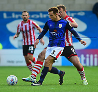 Lincoln City's Matt Rhead vies for possession with Crewe Alexandra's Harry Pickering<br /> <br /> Photographer Andrew Vaughan/CameraSport<br /> <br /> The EFL Sky Bet League Two - Lincoln City v Crewe Alexandra - Saturday 6th October 2018 - Sincil Bank - Lincoln<br /> <br /> World Copyright &copy; 2018 CameraSport. All rights reserved. 43 Linden Ave. Countesthorpe. Leicester. England. LE8 5PG - Tel: +44 (0) 116 277 4147 - admin@camerasport.com - www.camerasport.com