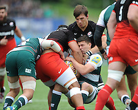 Ben Youngs of Leicester Tigers is wrapped up by Michael Rhodes and Billy Vunipola of Saracens during the Aviva Premiership semi final match between Saracens and Leicester Tigers at Allianz Park on Saturday 21st May 2016 (Photo: Rob Munro/Stewart Communications)
