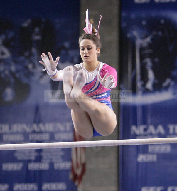 UK freshamn Alexis Gross performs on the uneven bars during the gymnastics meet between Kentucky, Auburn, and Pittsburgh on 2/24/12 at Memorial Coliseum in Lexington, Ky. Photo by Quianna Lige | Staff