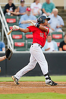 Cleuluis Rondon (13) of the Kannapolis Intimidators follows through on his swing against the Delmarva Shorebirds at CMC-Northeast Stadium on August 8, 2013 in Kannapolis, North Carolina.  The Shorebirds defeated the Intimidators 4-3.  (Brian Westerholt/Four Seam Images)