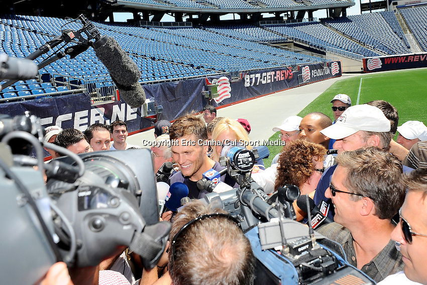 MAY 31 2012  New England Patriots quarterback Tom Brady #12 answering questions on the field at Gillette Stadium, after the team's OTA's  in  Foxborough, Massachusetts. Eric Canha/CSM