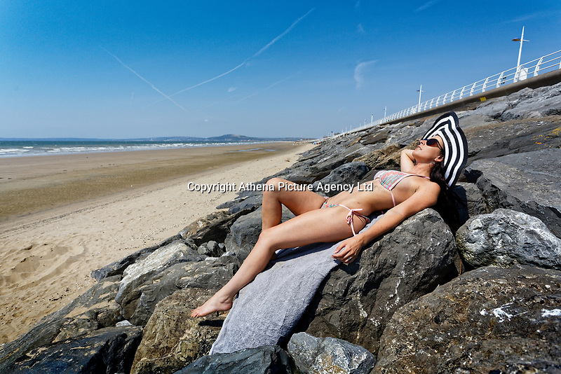 Natasha Jenkins makes the most of the sunny hot weather on Aberavon Beach in south Wales, UK. Saturday 07 July 2018