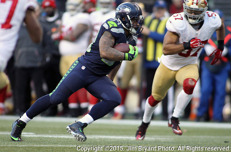 Seattle Seahawks running back Thomas Rawls (34) runs past Francisco 49ers linebacker Michael Wilhoite (57) on his way to a 31-yard touchdown at CenturyLink Field in Seattle, Washington on November 22, 2015.  The Seahawks beat the 49ers 29-13.   ©2015. Jim Bryant Photo. All RIghts Reserved.