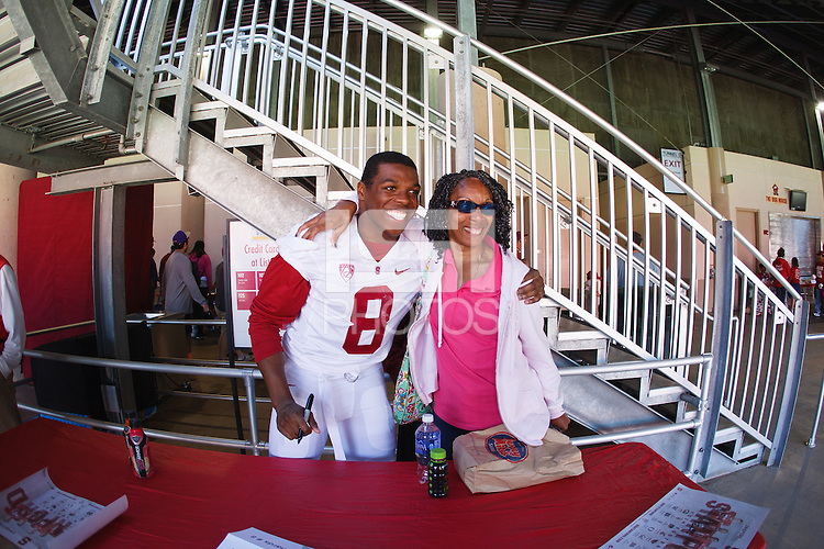 Stanford,CA-- April 12, 2014: Jordan Richards poses with fans after the Cardinal and White Spring Game Saturday afternoon at Stanford Stadium
