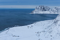 Winter view over snow covered Uttakleiv beach from summit of Mannen, Vestvågøy, Lofoten Islands, Norway