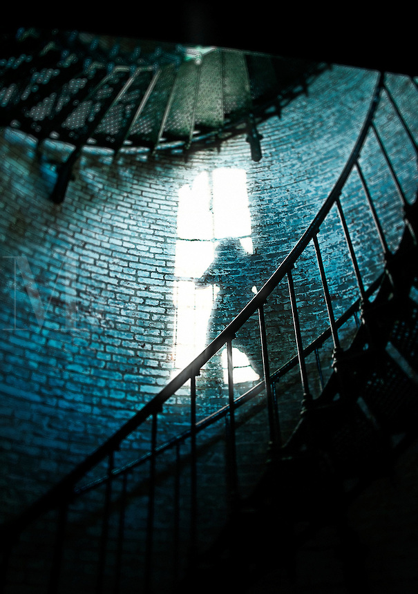Shadow figure in lighthouse window.