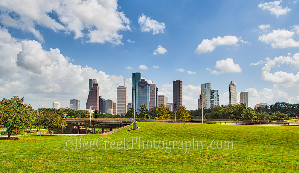 It was a beautiful day in the park with the nice green grass and the blue skies with puffy white clouds with the houston skyline in the background everything was almost perfect except the 85 % humidity.  Other than that it was a beautiful day to enjoy the park.