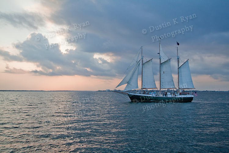 Schooner Pride sunset sailboat in the Charleston Harbor tall ship