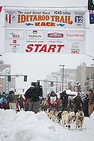 Paul Gebhardt leaves the 2011 Iditarod ceremonial start line in downtown Anchorage, during the 2012 Iditarod..Jim R. Kohl/Iditarodphotos.com