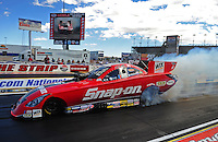 Apr. 3, 2011; Las Vegas, NV, USA: NHRA funny car driver Cruz Pedregon does a burnout during the Summitracing.com Nationals at The Strip in Las Vegas. Mandatory Credit: Mark J. Rebilas-